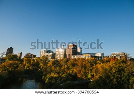 MINNEAPOLIS, USA - OCTOBER 12: Downtown Minneapolis, Minnesota view from the near Stone Arch Bridge in autumn - stock photo