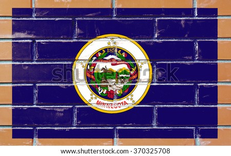 Minnesota state flag of America on brick wall - stock photo
