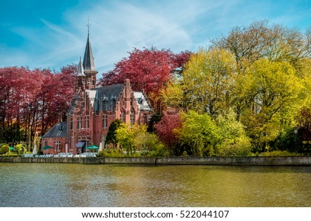 Minnewater castle at the Lake of Love in Bruges, Belgium