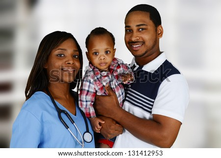 Minority nurse working at her job in a hospital with family