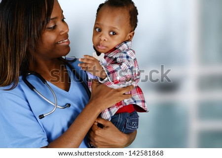 Minority nurse working at her job in a hospital with family - stock photo