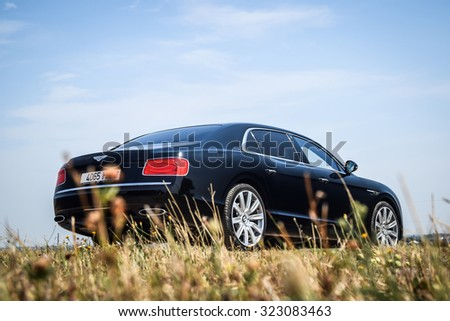 MINSK - AUGUST 10, 2014: Bentley Flying Spur W12 at the test drive event for automotive journalists. Flying Spur is powered by 6.0 liter W12 twin-turbo (produces 625 hp of power and 800 Nm of torque).