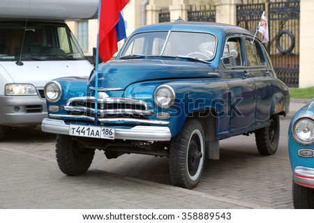 MINSK, BELARUS - APRIL 30, 2013: all wheel drive Soviet GAZ M-72 car from Russia  taking part in a rally to celebrate the WWII victory