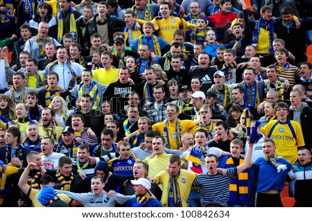 MINSK, BELARUS - APRIL 21:FC Bate Borisov VS FC Dynamo Minsk, Fans(FC BATE) celebrating a goal on football / soccer match on April 21, 2012 in Minsk, Belarus - stock photo