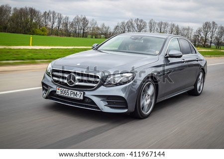 MINSK, BELARUS - APRIL 21, 2016: 2016 model year Mercedes-Benz E220d. The new E-Class is engineered to deliver more comfort, more efficiency and a more connected drive than ever before. - stock photo