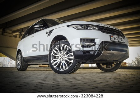 MINSK, BELARUS - APRIL 6, 2014: 2015 model year Range Rover Sport 3.0 Supercharged at the test-drive. British sport SUV is powered by 3.0 liter V6 (340 hp & 450 Nm). - stock photo