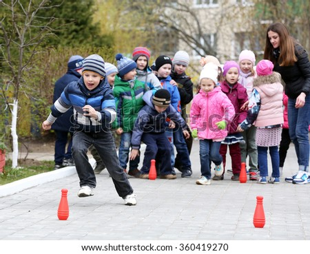 MINSK, BELARUS - APRIL 24, 2015: preschool kids playing outdoors