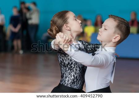 Minsk, Belarus-April 3, 2016: Unidentified Dance Couple Performs Juvenile-1 Standard European Program on the IDSA Championship Kinezis Star Cup-2016 in April 3, 2016 in Minsk, Republic of Belarus - stock photo