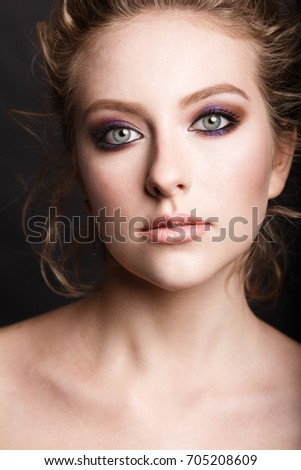 MINSK, BELARUS - AUGUST 28, 2017: Beauty fashion portrait. Master class on makeup. Professional studio photo. Retouch. Very pretty girl model. Shooting for a glossy magazine.