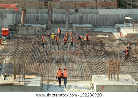 Minsk, Belarus, August 27, 2013: Construction of Turkish workers Renaissance Hotel in the center of Minsk - stock photo
