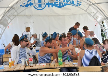MINSK, BELARUS AUGUST 2, 2015: Unidentified paratroopers in a cafe during the celebration of the Paratroopers VDV Day on 2 August 2015 in Minsk. - stock photo