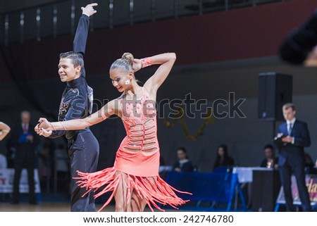 Minsk-Belarus, December 20,2014:Belarussian couple of Kolesnev Sergey and Buldyk Arina performs Adult Latin-American program on Gold of The Capital IDSA Contest on December 20, 2014,Minsk,Belarus - stock photo