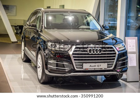 MINSK, BELARUS - DECEMBER 3, 2015: 2015 model year all-new Audi Q7 3.0 TFSI on display in the dealer showroom in Minsk, Belarus. Audi Q7 SUV is powered by 3.0 liter supercharged engine (333 hp). - stock photo
