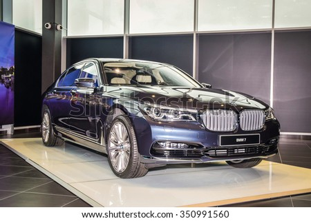 MINSK, BELARUS - DECEMBER 2, 2015: 2016 model year all-new BMW 7 series (750i xDrive) is on display in the dealer showroom in Minsk, Belarus. - stock photo