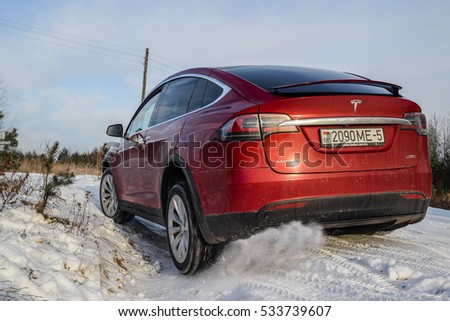 MINSK, BELARUS - DECEMBER 9, 2016: Tesla Model X P90D at the off-road test-drive. Model X is the fastest and most capable SUV in history. It accelerates from zero to 60 miles per hour in 3.3 seconds.
