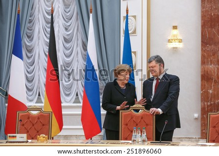 MINSK, BELARUS - Feb 11, 2015: Chancellor of the Federal Republic of Germany Angela Merkel and President of Ukraine Poroshenko before talks the leaders of states in the Norman format in Minsk - stock photo
