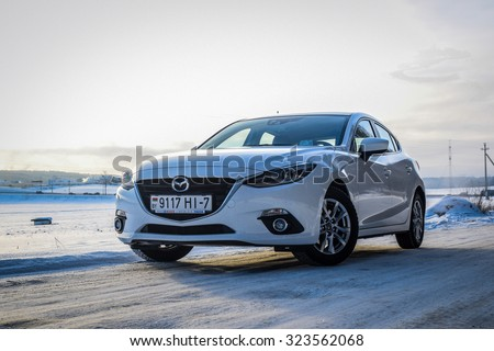 MINSK, BELARUS - JANUARY 10, 2014: All-new Mazda 3 2.0 Skyactiv at test-drive event in Minsk, Belarus. The new Mazda 3 is one of the best-handling cars in its class. - stock photo