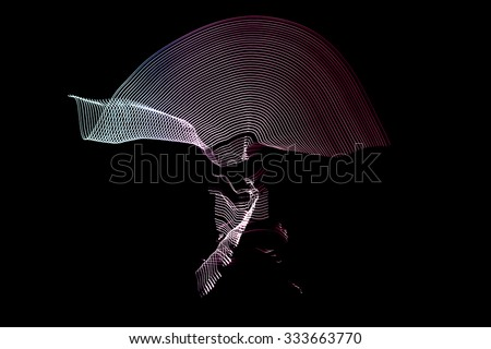 Minsk, Belarus - january 11, 2014: man in the LED tape makes movements of capoeira Capoeira is a Brazilian martial art - stock photo
