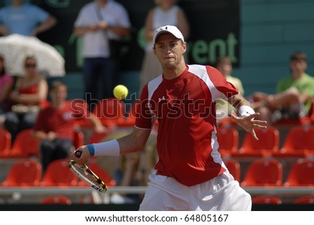 MINSK, BELARUS - JULE 11: Vladimir Ignatik play against netherlands player in the Davis Cup on Jule 11, 2010 in Minsk, Belarus - stock photo