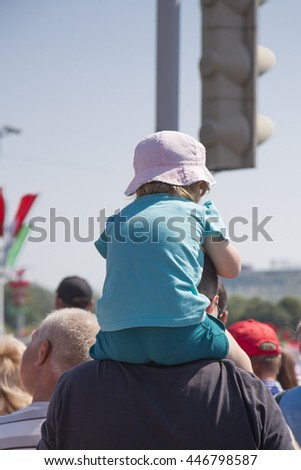 MINSK, BELARUS - JULY 3: Little girl on the father's neck, watching parade on Independence Day on 3 of July, 2016 in Minsk, Belarus.