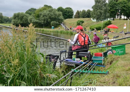 """MINSK, BELARUS - JUNE 29, 2013: Annual fishing competition """"RS Cup"""". The contest takes place yearly, on the last weekend of June, in the center of Minsk, on the Svisloch river. - stock photo"""