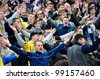 MINSK, BELARUS - MARCH 25: Fans celebrating a goal on football / soccer match FC BATE Borisov against FC MINSK on March 25, 2012 in Minsk, Belarus - stock photo