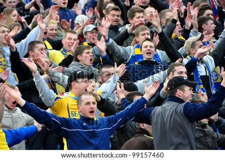 MINSK, BELARUS - MARCH 25: Fans celebrating a goal on football / soccer match FC BATE Borisov against FC MINSK on March 25, 2012 in Minsk, Belarus