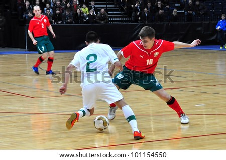 MINSK, BELARUS - MARCH 26: qualification World Cup 2012, Belarus � Portugal: Vladimir Zhigalko (10) selects a ball from an unknown Portuguese footballer on March 26, 2012 in Minsk, Belarus - stock photo