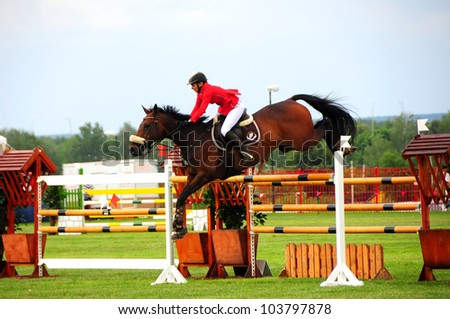 MINSK, BELARUS - MAY 27: Anna Gromzina from Russia (winner in (CSIO2*-W 160 ??) competes in final during KAP JUMPING HORSE SHOW 2012 on May 27, 2012 in Minsk, Belarus. - stock photo