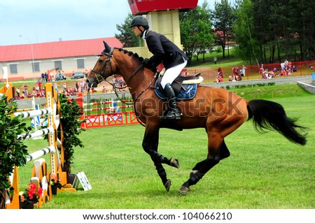 MINSK, BELARUS - MAY 27: Benas GUTKAUSKAS (LTU) before the barrier in  competition (CSIO2*-W 160cm) during KAP JUMPING HORSE SHOW 2012 on May 27, 2012 in Minsk, Belarus. - stock photo