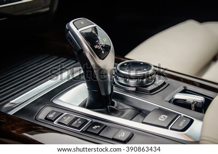 MINSK, BELARUS - MAY 6, 2015: close-up photo of a new style gear selector of automatic gearbox of the 2015 model year all-new BMW X5 M50d.