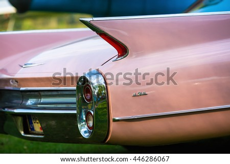MINSK, BELARUS - MAY 07, 2016: Close-up photo of pink Cadillac de Ville. Back view of retro car. Selective focus.