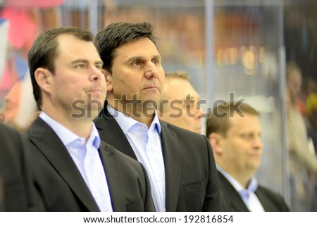 MINSK, BELARUS - MAY 14: Czech Republic's head coach, Ruzicka Vladimir looks on flag after preliminary round action at the 2014 IIHF Ice Hockey World Championship on May 14, 2014 in Minsk, Belarus.
