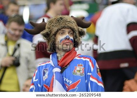 MINSK, BELARUS - MAY 17: Fan of Russia during 2014 IIHF World Ice Hockey Championship match at Minsk Arena on May 17, 2014 in Minsk, Belarus. - stock photo