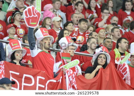 MINSK, BELARUS - MAY 17: Fans of Belarus during 2014 IIHF World Ice Hockey Championship match at Minsk Arena on May 17, 2014 in Minsk, Belarus. - stock photo