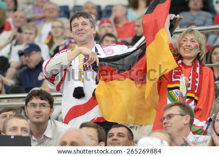 MINSK, BELARUS - MAY 20: Fans of Germany during 2014 IIHF World Ice Hockey Championship match at Minsk Arena on May 20, 2014 in Minsk, Belarus. - stock photo