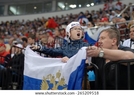 MINSK, BELARUS - MAY 17: Fans of Russia during 2014 IIHF World Ice Hockey Championship match at Minsk Arena on May 17, 2014 in Minsk, Belarus. - stock photo