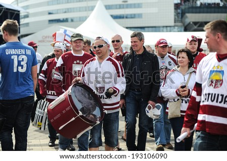 MINSK, BELARUS - MAY 10, 2014: Hockey fans from Latvia, and one of them with a drum