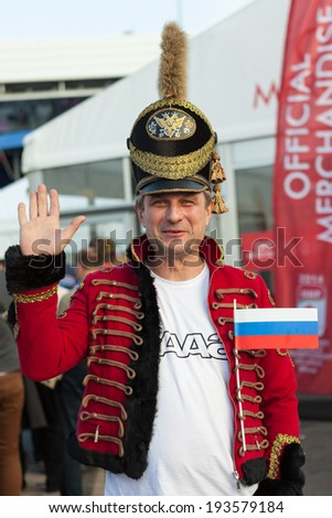 MINSK, BELARUS - May 18, 2014: ICE HOCKEY WORLD CHAMPIONSHIP, MINSK-ARENA, The hockey fan from Russia in national vintage military uniform - stock photo