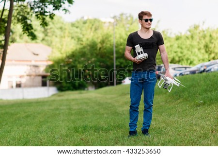 MINSK, BELARUS-May 26, 2016:Man holding drone quadcopter Dji Phantom 2 with digital camera GoPro HERO4