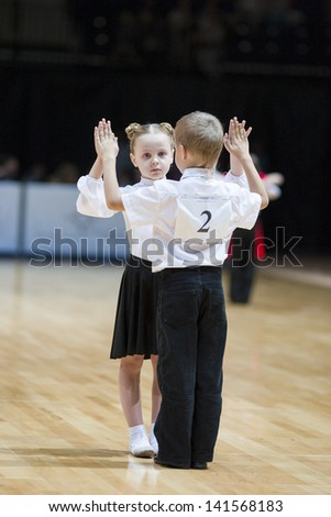 MINSK-BELARUS, MAY, 18: Unidentified Dance couple performs Baby program on World Open Minsk 2013 Championship of the Republic of Belarus 2013 in May 18, 2013 in Minsk, Republic Of Belarus