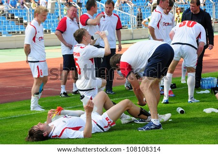 MINSK, BELARUS MAY 20: Unidentified players (FC MINSK) resting in before additional time during final cup match between FC NAFTAN and FC MINSK on May 20, 2012 in Minsk, Belarus