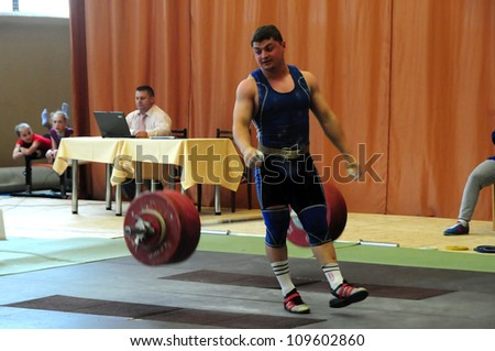 MINSK, BELARUS MAY 31: Unidentified sportsman  has bad attempt during Belarus Open Championship in weightlifting on May 31, 2012 in Minsk, Belarus