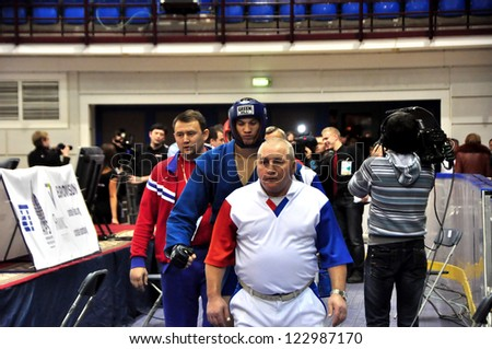 MINSK, BELARUS - NOVEMBER 10: Ivanov A. from Russia a seconds before the final match during SAMBO (Wrestling) WORLDCh-2012 on November 10, 2012 in Minsk, Belarus. - stock photo