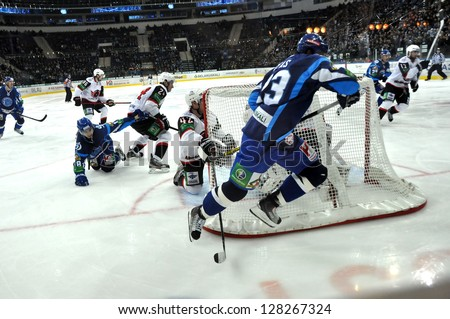 MINSK, BELARUS - NOVEMBER 28: Unidentified Dynamo players  in attack during KHL regular match Dynamo Minsk VS Avtomobilist  Yekaterinburg on November 28, 2012 in Minsk, Belarus. - stock photo