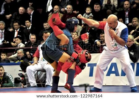 MINSK, BELARUS - NOVEMBER 10: Unidentified sportsmen wrestle during SAMBO WORLDCh-2012 on November 10, 2012 in Minsk, Belarus. - stock photo