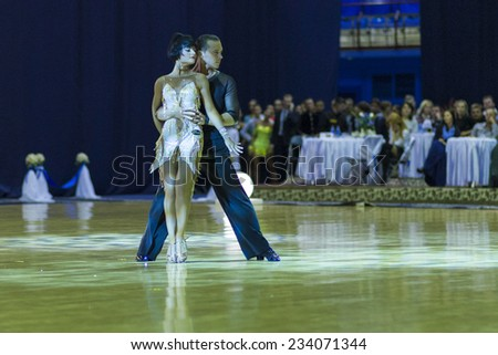 Minsk-Belarus,October 4,2014:Andrey Zaycev and Elizaveta Cherevichnaya(Russia) perform Latin-American Program Performance on World Open Minsk-2014 WDSF Championship in October 4,2014 in Minsk,Belarus - stock photo