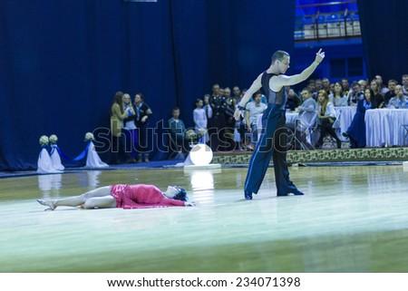Minsk-Belarus,October 4,2014:Andrey Zaycev and Elizaveta Cherevichnaya(Russia)perform Latin-American Program Performance on World Open Minsk-2014 WDSF Championship in October 4,2014 in Minsk,Belarus - stock photo
