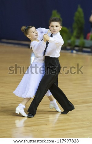 MINSK-BELARUS, OCTOBER, 21: Unidentified Dance Couple performs Youth Latin Program on STYLE CUP Minsk 2012 WDSF  Championship on October 21, 2012, in Minsk, Belarus