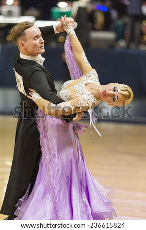 Minsk-Belarus, October 5, 2014: Unidentified Professional dance couple performs Adult Standard program on World Open Minsk-2014 WDSF Championship in October 5, 2014 in Minsk, Republic Of Belarus